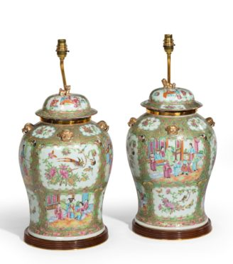A pair of Chinese Famille Verte Vases and Covers