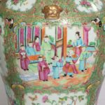 A pair of Chinese Famille Verte Vases and Covers detail