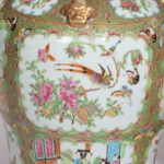 A pair of Chinese Famille Verte Vases and Covers details