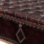A mahogany box ottoman detail