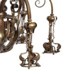 A pair of large Victorian 8-light brass chandeliers detail