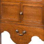 A George III mahogany tray top commode from the Chippendale period front details