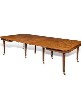An 'imperial' action mahogany extending dining table attributed to Gillows