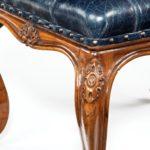 A mid-Victorian walnut stool leg detail