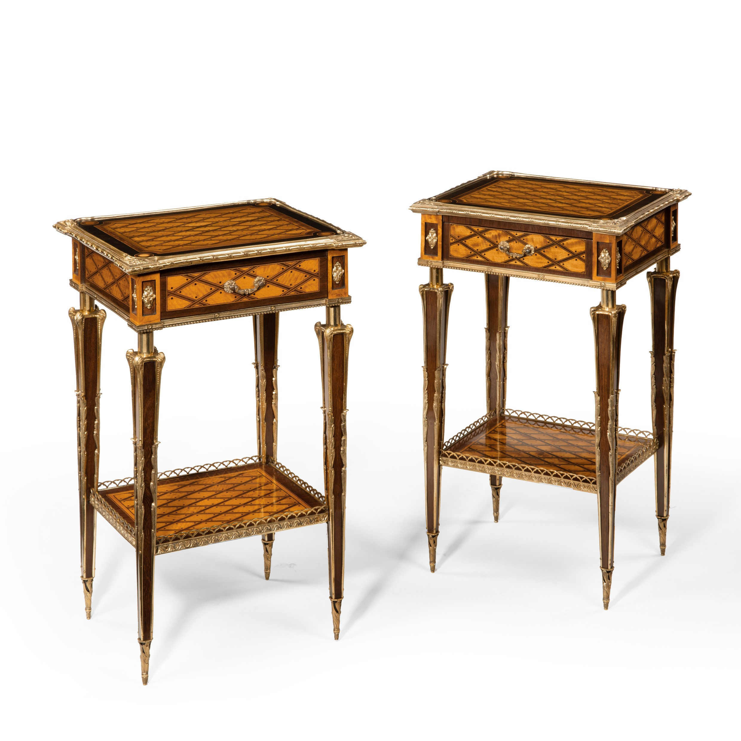 A matched pair of satinwood tables after Donald Ross, retailed by Edwards and Roberts