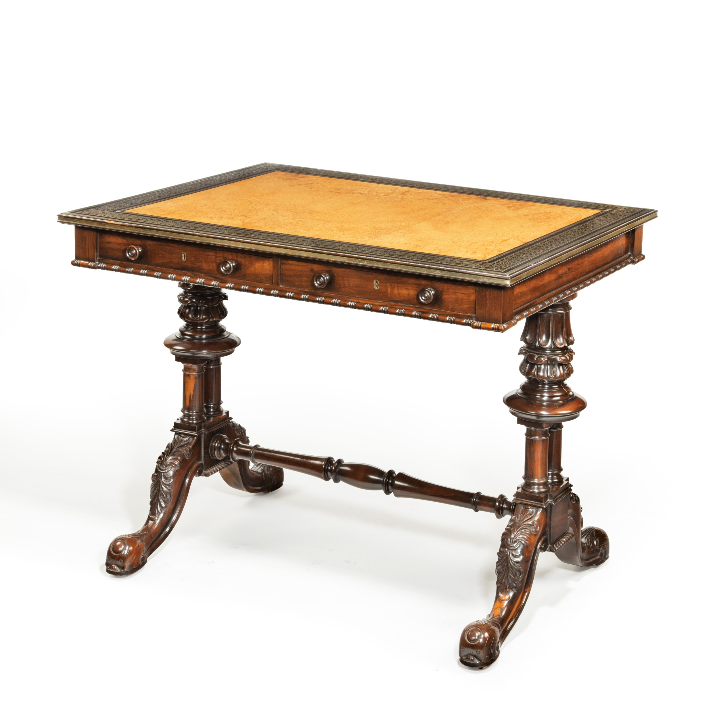 A striking Goncalo Alves (Albuera wood) writing table attributed to Gillows and Bullock
