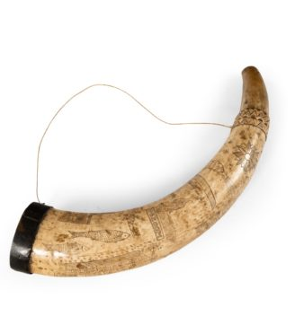 A sailor's carved cow horn. English, circa 1810