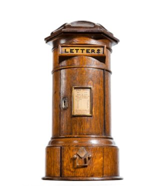 A Victorian oak country house letterbox by Rodrigues, dated 1872,