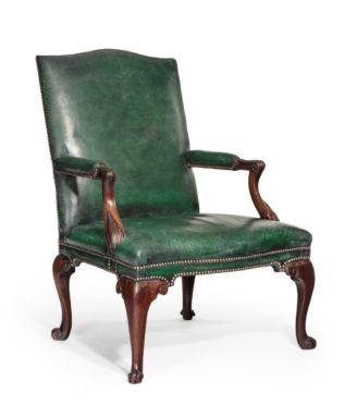 A George III Chippendale period mahogany wing arm chair