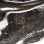 A Meiji period bronze study of lions stamp