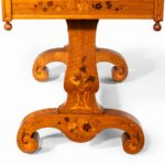A Victorian walnut marquetry writing table attributed to Edward Holmes Baldock leg