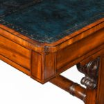 A Regency mahogany end support library table corner
