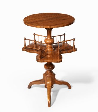 A Victorian walnut revolving book table