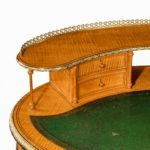 An unusual Victorian freestanding oval satinwood desk top