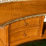 An unusual Victorian freestanding oval satinwood desk top drawers