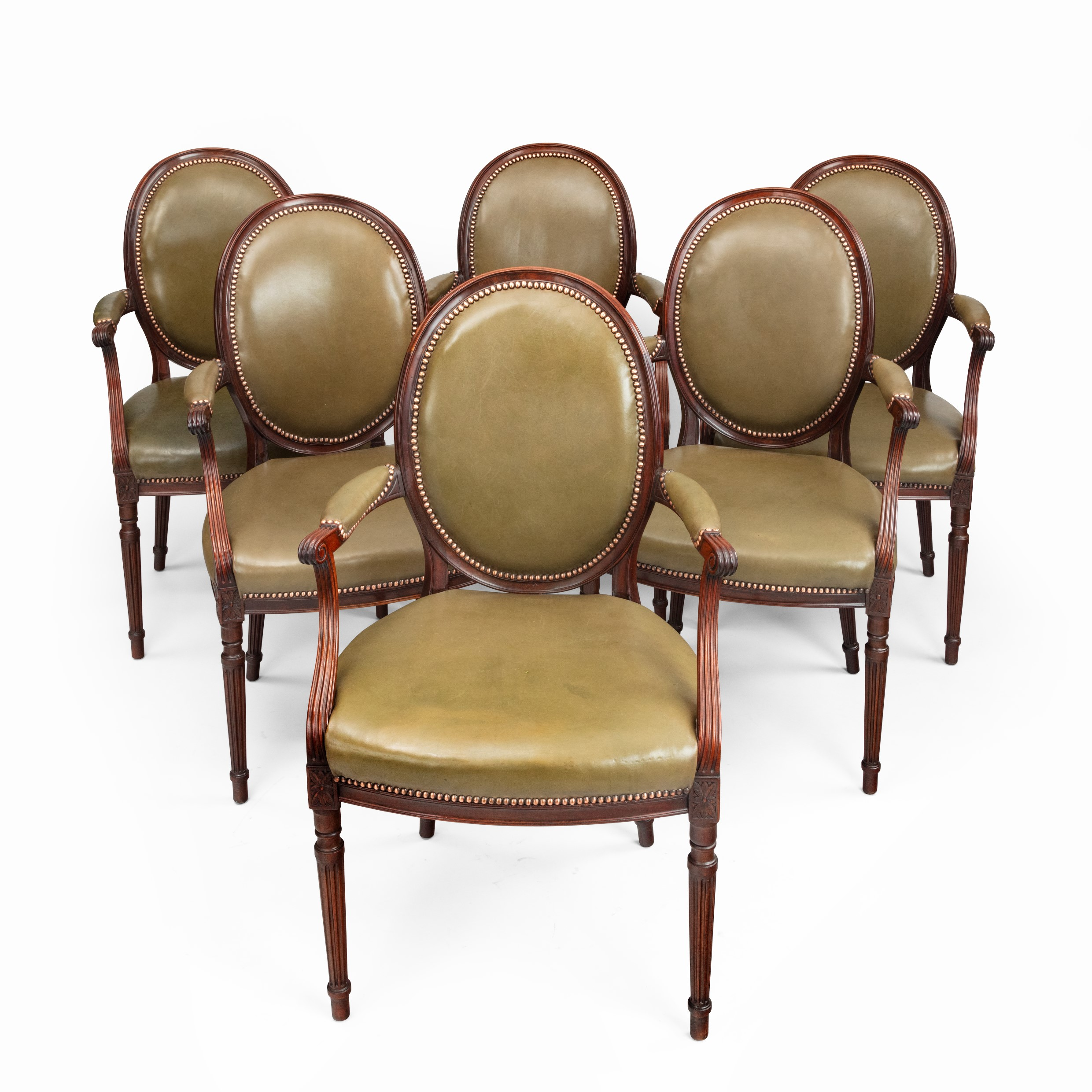 Six Edwardian mahogany chairs by Gill & Reigate