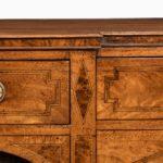 George III breakfront yew-wood inlaid sideboard close up
