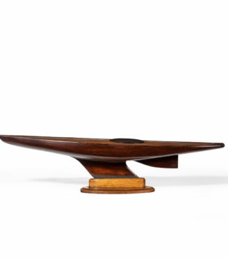 An Unusual static model of a marble head pond yacht stood upon its original shaped oak stand.