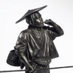 A Meiji period bronze of a cricket catcher