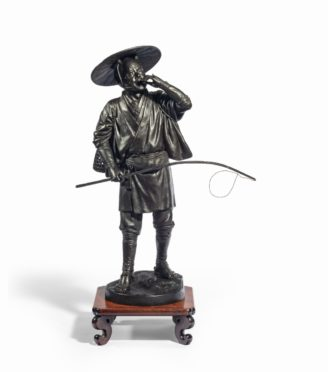 A Meiji period bronze of a cricket catcher