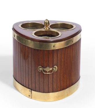 A George III mahogany and brass mounted wine cooler