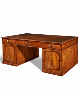 A late George III mahogany partner's desk top main