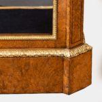 A Mid Victorian burr walnut display cabinet corner