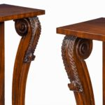 Pair of late Regency flame mahogany console tables scrolls