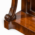 Pair of late Regency flame mahogany console tables