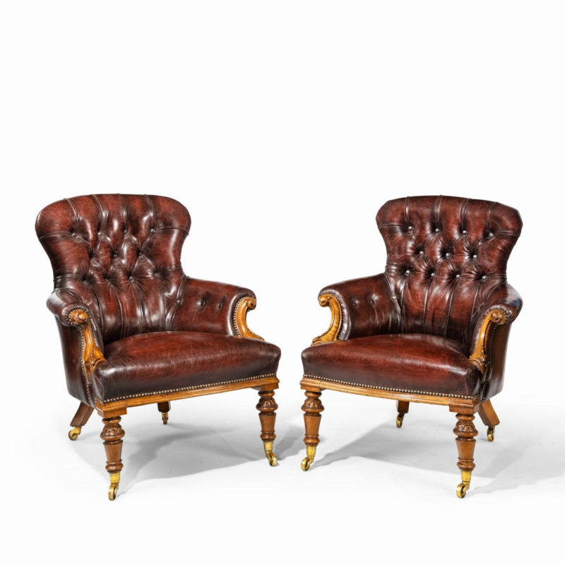 A pair of Victorian walnut library armchairs