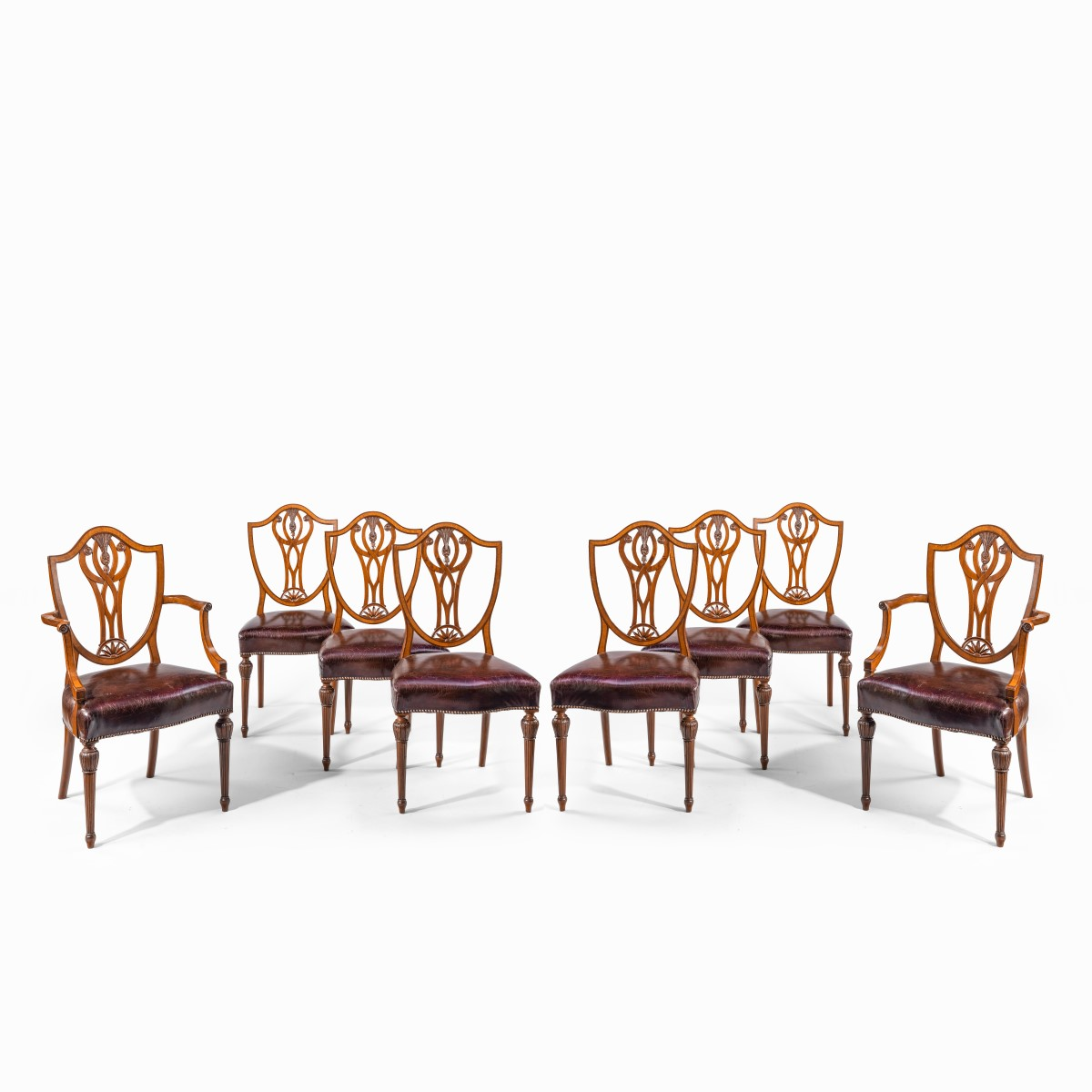 Set of eight late Victorian Hepplewhite Revival mahogany dining chairs