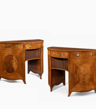 A fine pair of George III figured mahogany side cabinets, in the manner of Thomas Sheraton Main
