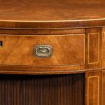 fine pair of George III figured mahogany side cabinets, in the manner of Thomas Sheraton handle