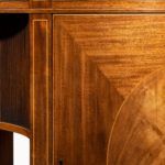 A fine pair of George III figured mahogany side cabinets, in the manner of Thomas Sheraton details