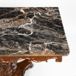 Anglo-Indian mahogany table with Nero portoro marble top by White and Co Calcutta, all on an X-shaped base with scroll feet, stamped 'White and Co Calcutta' marble detail
