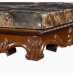 Anglo-Indian mahogany table with Nero portoro marble top by White and Co Calcutta, all on an X-shaped base with scroll feet marble corner