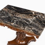 Anglo-Indian mahogany table with Nero portoro marble top by White and Co Calcutta, all on an X-shaped base with scroll feet marble detailing