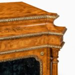 A pair of Victorian satinwood display cabinets attributed to Holland and Sons side