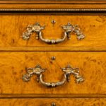 A fine George IV burr oak chest of drawers in the manner of Morel and Seddon handles