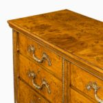 A fine George IV burr oak chest of drawers in the manner of Morel and Seddon top corner
