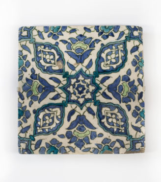 An Ottoman Empire Damascus square tile, late 16th century, the glazed fritware body painted in underglaze green, blue, turquoise and black with four lobed medallions and four split palmettes centred on an eight-pointed floral star, mounted . Syrian.