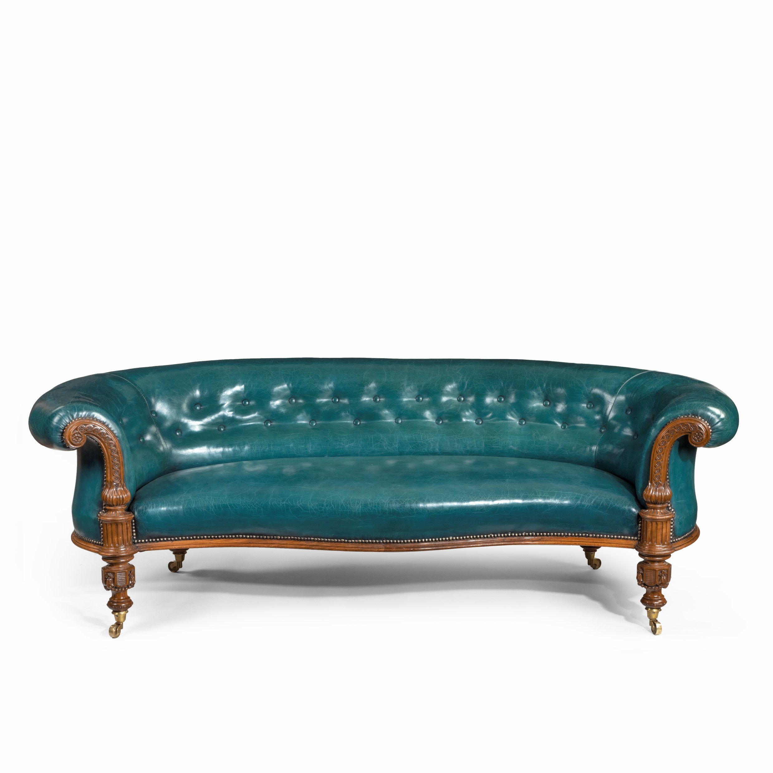 A Victorian carved walnut leathered sofa
