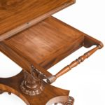 A companion pair of William IV flame-mahogany card table single slide