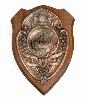 A HMS Victory centennial copper shield