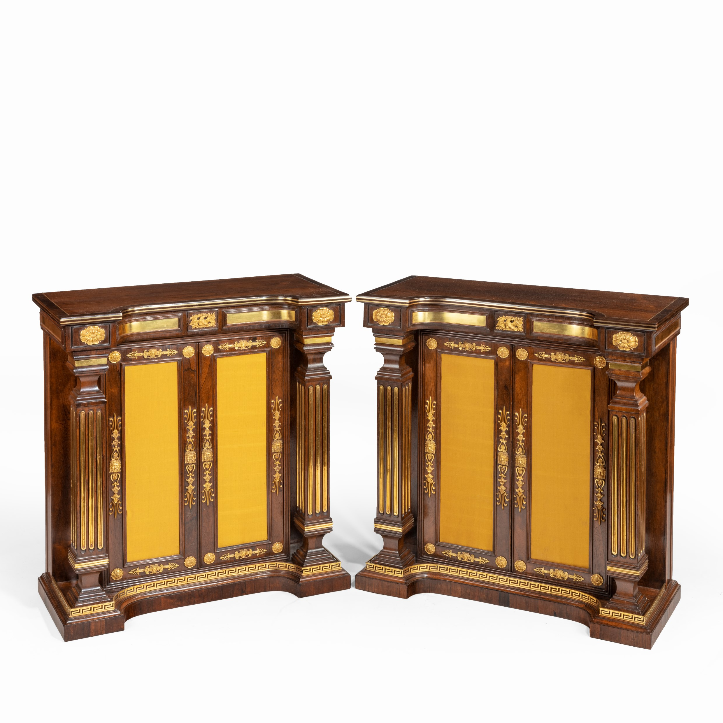 A pair of Regency brass-inlaid rosewood side cabinets