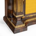 A pair of Regency brass-inlaid rosewood side cabinets legs