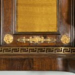 A pair of Regency brass-inlaid rosewood side cabinets doors details