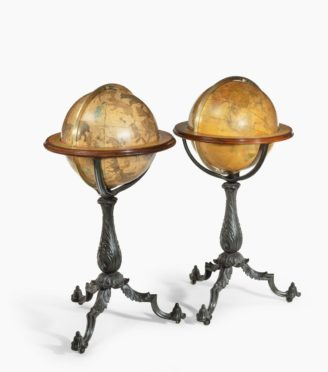A Pair of 16-inch floor standing globes by Gilman Joslin,