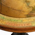 Pair of 16-inch floor standing globes by Gilman Joslin ring