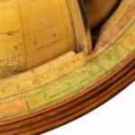 A Pair of 16-inch floor standing globes by Gilman Joslin closeup